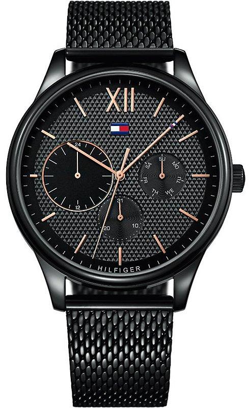 Elegancki, damski zegarek Tommy Hilfiger 1791420 na stalowej, czarnej bransolecie oraz kopercie z tych samych materiałów. Tarcza analogowa zegarka jest w czarnym kolorze z subtarczami w kolorze różowego złota.