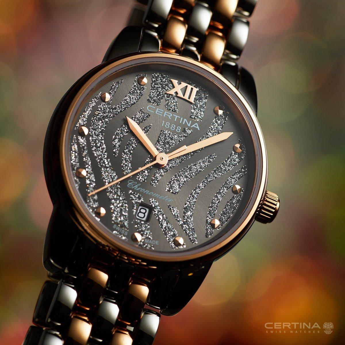 Kobiecy zegarek Cetina C033.051.22.088.00 DS-8 z piękną czarną tarczą w tygrysie prążki zrobioną z masy perłowej oraz brokatu.