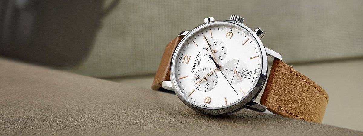 Zegarek Certina na brązowym pasku z subtarczami na tarczy.