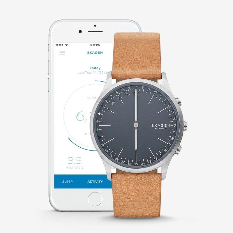 Stylowy, męski zegarek Skagen SKT1200 Jorn Connected na skórzanym pasku w rudym kolorze z koperta ze stali w srebrnym kolorze. Analogowa tarcza zegarka jest w niebieskim kolorze.