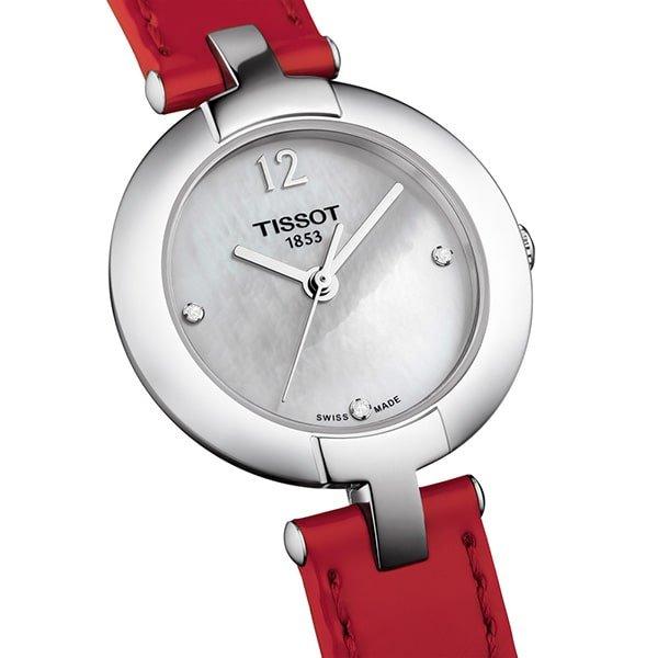 Eleganski zegarek Tissot na czerwonym pasku z kryształkami na tarczy.