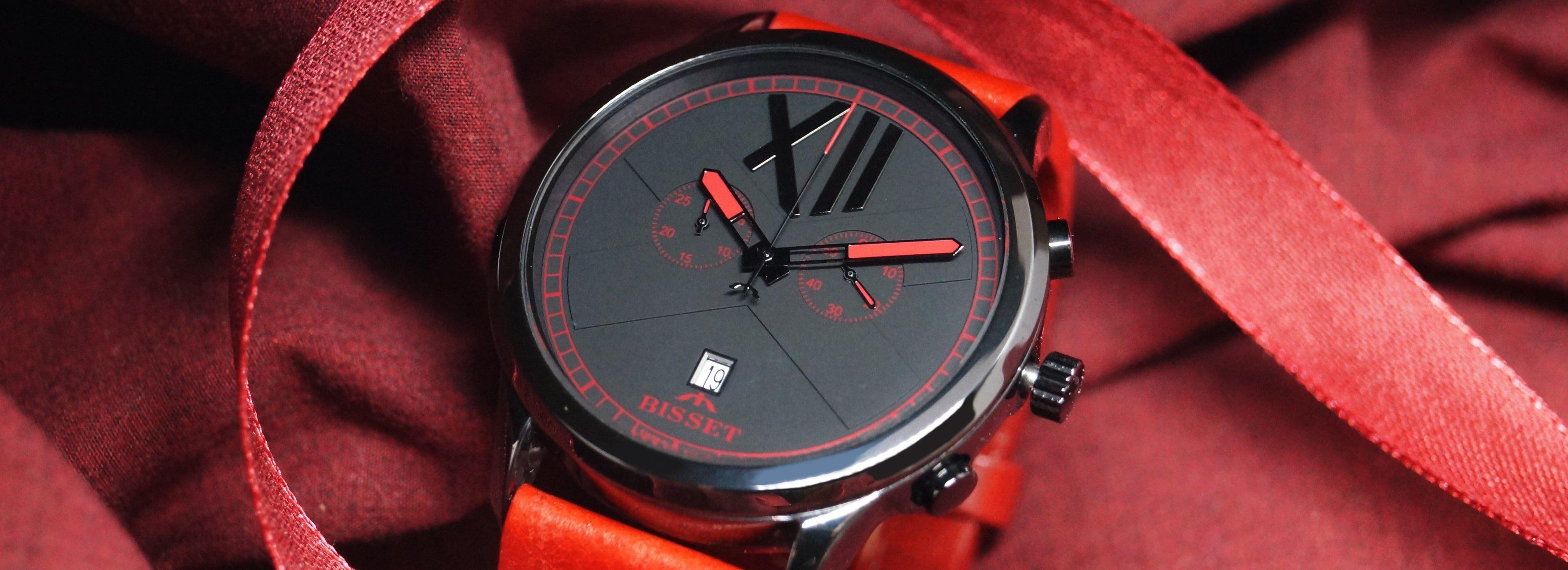 Elegancki, męski zegarek Bisset z czarną, ceramiczną tarczą ozdobioną czerwonymi akcentami.