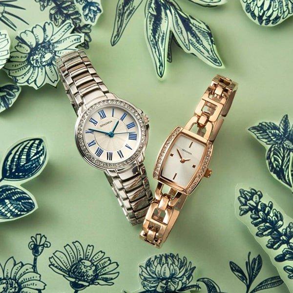 Eleganckie zegarki Sekonda na srebrnej i złotej bransolecie.