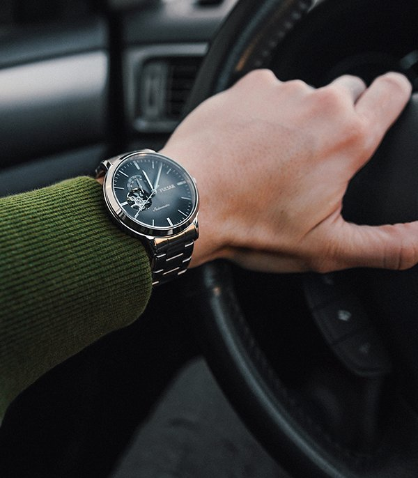 Męski zegarek Pulsar z tarczą open heart na srebrnej bransolecie