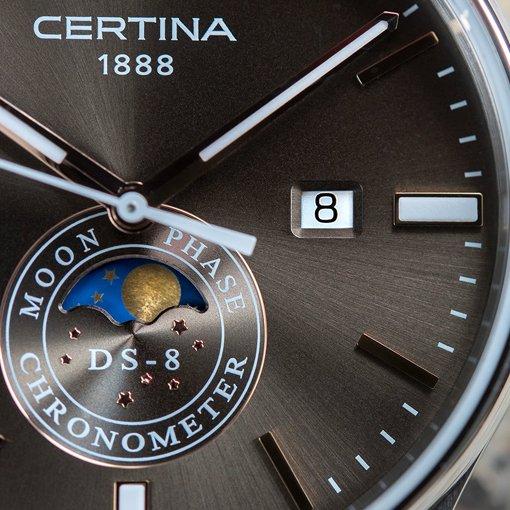 Zegarek Certina z tarczą pokazującą fazy księżyca w ciemnym szarym kolorze.