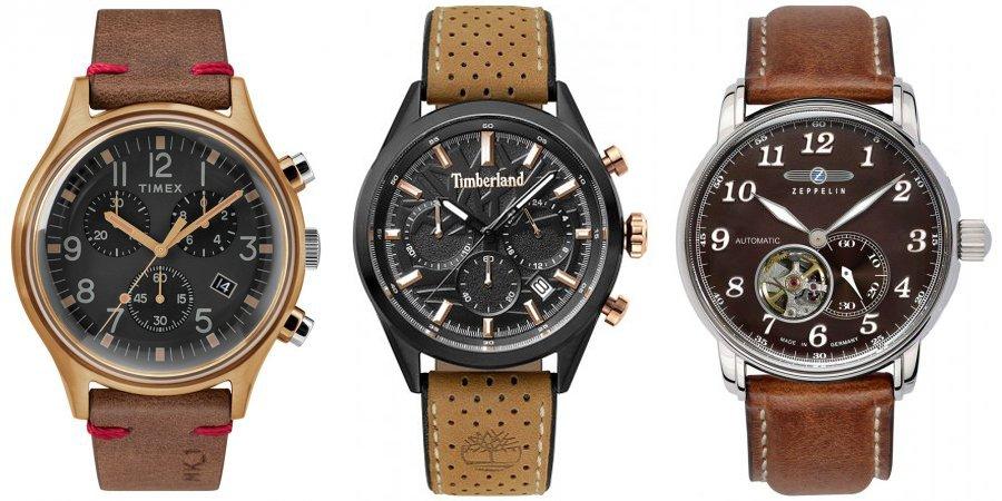 Jesienne, męskie zegarki Timex, Timberland, Zeppelin na brązowych skórzanych paskach. Timex oraz Timerland posiadają czarne tarcze, podczas gdy zegarek marki Zeppelin posiada brązową tarczę w stylu open-heart.