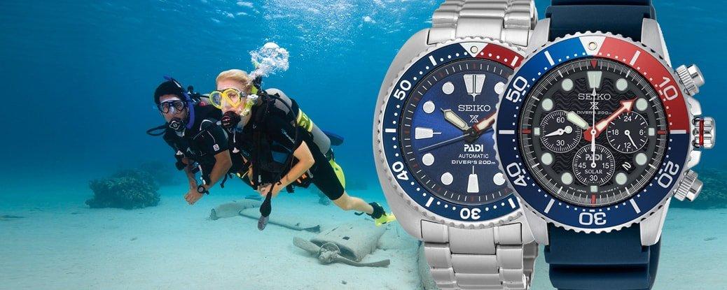 Sportowe, luksusowe, męskie zegarki Seiko Prospex SRPA21K1 Padi oraz SUN065P1 Padi Kinetic na srebrnej, stalowej bransolecie i pasku z tworzywa sztucznego w ciemnym, niebieskim kolorze. Oba zegarki przeznaczone są dla nurków i posiadają analogowe tarcze w niebieskim jak i czarnym kolorze. Bezele zegarków są w niebiesko - czerwonym kolorze nawiązującym do oceanicznego błękitu.
