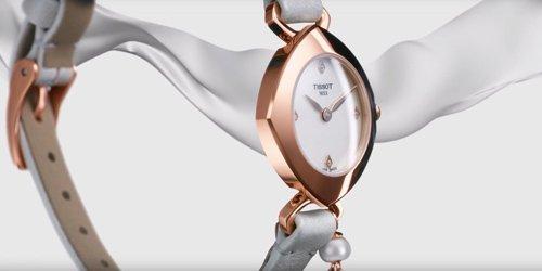 Subtelny, damski zegarek Tissot  T113.109.36.116.00 FEMINI-T DIAMONDS ze stalową kopertą w kolorze różowego złota na białym, skórzanym pasku.