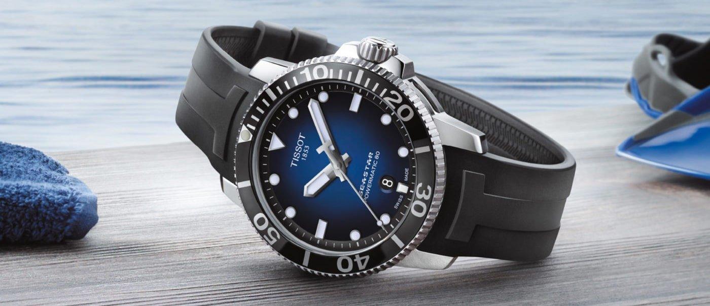 Wielofunkcyjny, męski zegarek Tissot T120.407.17.041.00 Seastar 1000 z pożytecznym datownikiem pokazującym dzień miesiąca w okienku nad godziną szóstą.