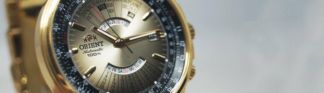 Złoty zegarek Orient z kalendarzem wiecznym na tarczy czyli rozszerzoną funkcją kalendarza.