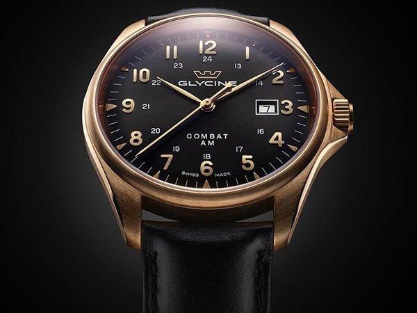 Szwajcarski zegarek Glycine na czarnym skórzanym pasku oraz tarczą w kolorze różowego złota