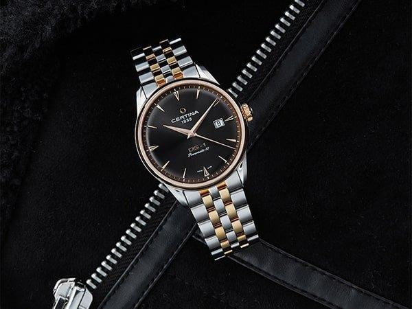 Elegancki zegarek Certina na bransolecie z czarną tarczą.