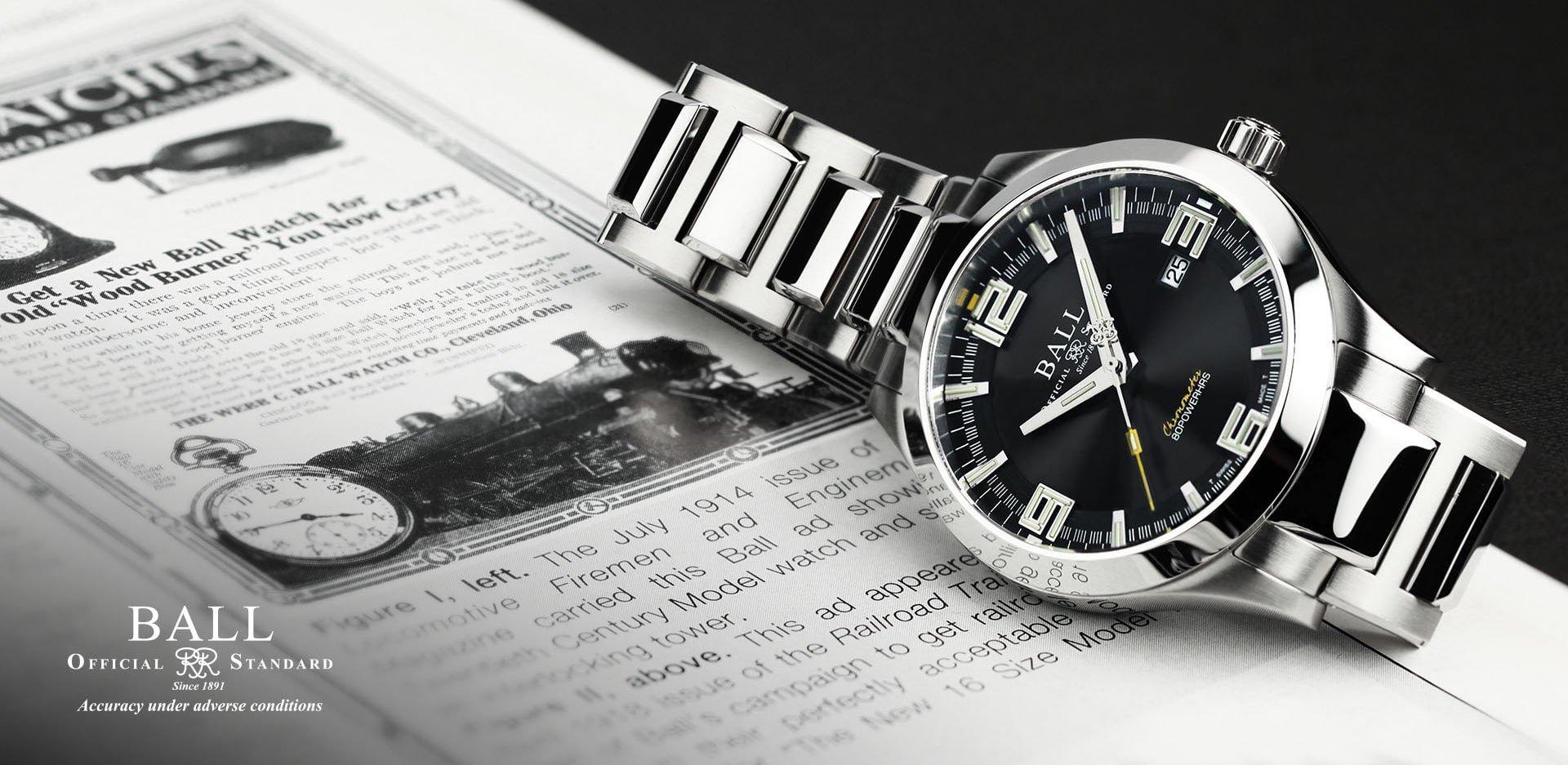 Niezwykle dokładny, męski zegarek Ball na srebrnej bransolecie z czarną tarczą oświetloną tubkami z trytem.